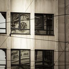 Sometimes reason is hard to find... (Sylvie.) Tags: antwerp antwerpen anvers nationalebankbelgi bank belgium street reflection desaturation window sylviepeeters sonyilce6000 sony a6000 clock old architecture 90mm fe90mmf28macrogoss sonyfe90mmf28 bankencrisis bankingcrisis