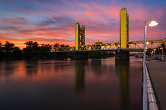 Tower Bridge Glow (boingyman.) Tags: california bridge light sunset water colors yellow river landscape downtown glow cityscape sacramento scape waterscape bridge river tower sacramento boingyman