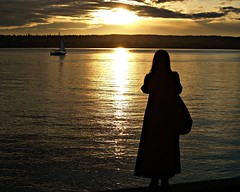 The Watcher (dons projects) Tags: ocean city winter sunset sea sun canada black beach water sunshine silhouette vancouver clouds sailboat golden boat downtown ship cityscape shadows sonnenuntergang bc sundown zoom candid sunny streetscene olympus seawall sparkle sail glowing englishbay sonnig sonne zuiko vancouverbc 2010 cityscene evolt e500 zd fourthirds 40150mm photoscape seeninvancouver kodakccd donsprojects