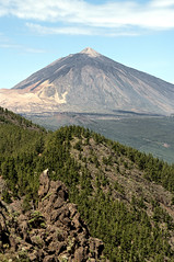 el teide (Francis Jimnez Meca) Tags: park travel blue sky cliff cloud mountain holiday rock stone composition landscape island volcano weird spain ancient place god antique finger air reserve conservation peak landmark tourist erosion formation national fancy area tenerife scree canary scar volcanic teide lunar interest martian sliderock clove singularity geological showplace crag vulcanic prehistorical