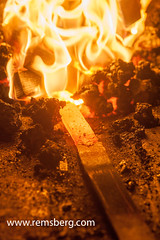 Bladesmith using coal stove to weld and hammer metal (Remsberg Photos) Tags: usa hot fire intense construction steel knife maryland heat blade blacksmith forge tradition damascus frederick coals smithing