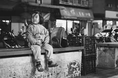 Daddy was late today.. (Seedmic) Tags: life street family autumn portrait blackandwhite bw white black girl face 50mm kid nikon toddler child expression helmet taiwan streetscene thoughts daisy taipei 365 primetime   pleasure afterschool pondering  d800  3y4m 3y5m seedmic