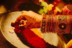 The Marriage traditions! (mukesh.barnwal) Tags: red india beauty bride coins ceremony traditions marriage ring bangle ethnic puja mehndi bangles