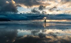 Surfers (nils.wachter) Tags: nikon tripod sport midnightsun sunset evening island lofoten norway water surfers