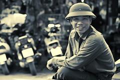 Haiphong - Man with helmet (sharko333) Tags: travel reise voyage asia asien asie vietnam haiphong people portrait man street helmet olympus em5