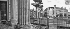I dream of salvation (alun.disley@ntlworld.com) Tags: chinatownliverpool city panorama blackandwhite mono weather culture architecture pillars people homeless atmospheric chinesearch fence urbanlife center merseyside uk tokina1116mkll
