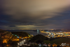 Watching With A Million Eyes (Tim van Zundert) Tags: great little orme llandudno conwy north wales landscape water sea coast seafront shoreline town hills night evening long exposure cloud sky light pollution sony a7r voigtlander 21mm ultron