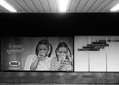 why do you like it (tamaratoth) Tags: white black twins kids milk underground metro poster commercial streetart lines hungary budapest sony digital city
