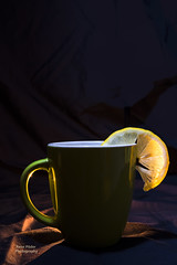 Tee with a lemon (rene10022) Tags: tee lemon cup light black candle green abstract drink reflection heart glow