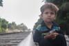 Street kid (asfandyarkohati) Tags: streetkids kids railway trainphotography train tracks pakistan photography poor cute canon canon60d children karachi unfocused blureffect blur blurphotography folkgood folkvibe streetlife