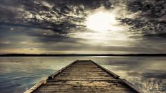 Enter the Light (Jens Haggren) Tags: olympus em1 sun sunrise morning sea water reflections sky clouds jetty landscape seascape nacka sweden