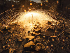 Raining Fire (Ffotograffiaeth Dylan Arnold Photography) Tags: fire wirewool dark sparks light trails bright reflections bokeh rocks leadin trees twisted quarry spinning raindrops path golden night eerie