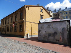 Murnieku Street in Riga, Latvia. Wednesday, May 1, 2013 (Vadiroma) Tags: city wall buildings painting wooden spring europe pavement flag capital baltic latvia riga lettland rga latvija cobbledstreet baltikum woodenarchitecture lettonie 2013 murniekustreet