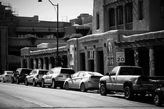 Cars At The Plaza (Mabry Campbell) Tags: street blackandwhite bw usa newmexico santafe cars buildings photography us photo photographer unitedstates image parking unitedstatesofamerica perspective 100mm photograph adobe 100 february nm f28 automobiles abode plaze 2013 santafecounty sec eos5dmarkiii ef100mmf28lmacroisusm mabrycampbell february172013 201302170h6a0586