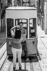Tram Tourists (Pauls-Pictures) Tags: street city vacation two people urban blackandwhite portugal smile pose photography couple lisbon candid pair travellers streetphotography posing tram sunny tourists lovers photograhy streetphotos streetpics streetphotograhy streetpictures