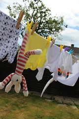 Stripes' bathtime (Joybot) Tags: stripes bunny laundry washing wash washed washday toy washingline drying dry line clothes baby babyclothes romper babygro babygrow vest cardigan white yellow garden