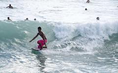 bodyboarding by the pier larger IMGP1078 (Guy: Jussum Guy) Tags: ocean people beach hawaii pier surf waikiki oahu honolulu walls bodyboard kapahulugroin pentaxk30