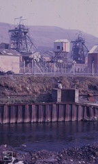 Aberfan double pithead, iron-fenced, Taff. 31/03/71 (Mary Gillham Archive Project) Tags: aberfan industry so068004 wales 1971 2955 31031971