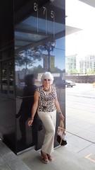 Woman Against A Wall (Laurette Victoria) Tags: laurette pants purse milwaukee downtown silver animalprint