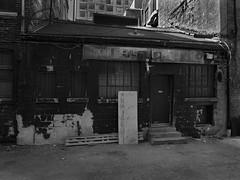 Addurians Rug (geowelch) Tags: toronto downtowneast kingst urbanfragments urbanlandscape store blackwhite panasoniclumixgx1 panasoniclumixgvario1232mm3556