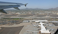 Leaving Phoenix Behind (craigsanders429) Tags: aircraft airports airlines airliners airportrunways phoenix phoenixskyharborairport departingaircraft americanairlines unitedairlines valleyofthesun mountains jets jetliners