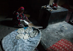 Afghan woman making bread inside her traditional pamiri house, Badakhshan province, Khandood, Afghanistan (Eric Lafforgue) Tags: 3034years adobe adult adultsonly afghan afghan352 afghani afghanistan badakhshanprovince bread centralasia colourimage community cultural darkness foodanddrink home horizontal house houses indigenousculture indoors interior ismaili khandood kitchen lifestyles oneperson onewomanonly oven photography poverty residential scene simple simplicity traditionalclothing unrecognizableperson wakhan wakhi women womenonly pamir