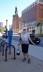 Laurette And City Hall (Laurette Victoria) Tags: milwaukee wisconsin cityhall laurette woman blouse purse silver sunglasses sidewalk