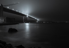 San Francisco in the Fog (Mike Boening Photography) Tags: sanfrancisco goldengatebridge blackandwhite monotone night longexposure ocean water fog spooky bridge