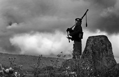 58 of 100 - Purity of Sound (linlaw39) Tags: scotland sky stonecircle tomnaveriestonecircle project100 aberdeenshire august2016 20082016 bagpiper bagpipes image58100 blackandwhite mono music