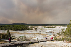 Visitors in Porcelain Basin at Norris Geyser Basin. Smoke filled sky from the Maple Fire (YellowstoneNPS) Tags: norrisgeyserbasin porcelainbasin smoke visitors yellowstonenationalpark