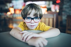 Chat'n chew. (aamith) Tags: kids candid portrait 24mm glasses eyes table waiting boy nikond750