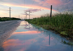 Powerline Road after the rain. (Jill Bazeley) Tags: high power lines reflection puddle powerline road melbourne florida brevard county vanishing point sunset dirt sony a6300 1670mm zeiss alpha space coast viera
