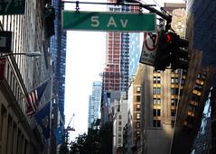 Tilting Reflection (mheidelberger2000) Tags: nyc newyorkcity urban reflection sign architecture 5thavenue americanflag canyon highrise artdeco signal uppereastside