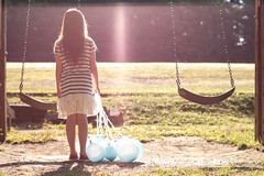 The party is over (Kilkennycat) Tags: park blue sunlight girl standing forest canon balloons children child stripes swings 50mm14 converse flare chucks chucktaylors 500d t1i