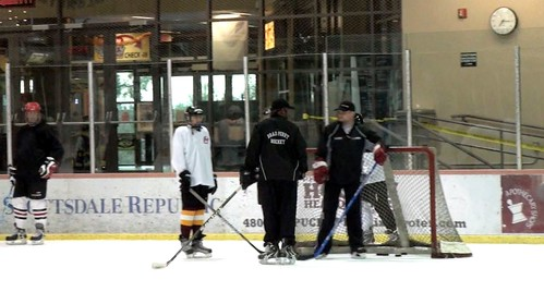 Brad Perry Coaching with Nate Arthurs at the ice den during and advanced adult session