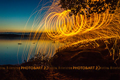 Fire stone (Chrisseee) Tags: sunset orange lake black silhouette night finland dark fire dock spinning steelwool wirewool kukkia