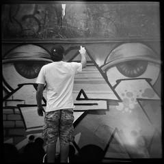 De Ogen (robert schneider (rolopix)) Tags: blackandwhite bw holland 120 film netherlands monochrome amsterdam mediumformat square graffiti eyes artist 4x4 kodak tx trix toycamera nederland lightleak diana spraypaint clone expired plasticcamera outdated outofdate 120620 robertschneider autaut hiflash believeinfilm rolopix deogen