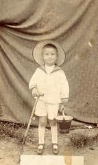 A makeshift beach studio (lovedaylemon) Tags: boy hat vintage studio found seaside bucket image photograph spade