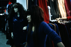 on cheap road (-{ ThusOriginal }-) Tags: cheaproad clothingshop color contaxt3 film fuji provia400 ratediso1600 shanghai thusihaveseen winter woman  thusoriginal scan