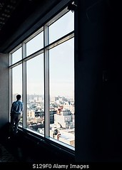 Uploaded to Stockimo (mlovette) Tags: new york nyc travel urban man window silhouette skyline thought cityscape looking business thinking traveler stockimo