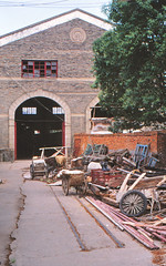 Along lost lines - China Yunnan - Mengzi (railasia) Tags: china yunnan mengzi cnr 600mm infra servicebuilding workshop outofservice demolishing leftinfra losttrack 2002