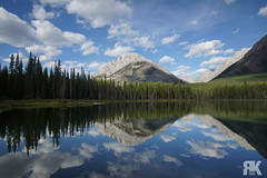 Buller Pond (ryan.kole32) Tags: canmore canmorealberta alaberta canada canadianrockies rockies rockymountains bluesky clouds cloudy bullerpond water shore trees forest mirrorimage reflection landscape nature beauty beautyinnature travel outdoors hiking sony sonya77 kananaskis kananaskiscountry peaceful calm serene serenity