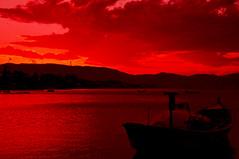 Lagoa da Conceio (telmofilho) Tags: sunset brasil telmofilho floripa florianopolis lagoa lagoadaconceio lake red redsky barco pordosol