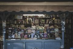 Madrid Oculto (Bokehneer) Tags: newstand books comics madrid spain libros graphicnovel stand seller parquedelretiro blue full literary man shop