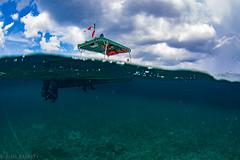 Cozumel (jcl8888) Tags: diving overunder nauticam nikon d7200 fisheye tokina 1017mm cozumel mexico boat ocean sea clouds underwater