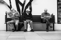 Some reading newspaper, others reading faces (Mahmoud Abuabdou) Tags: street streetphotography black bw blackandwhite white bench old men reading newspaper watching face faces contrast concentrate indoor malm sweden sverige people candid monochrome mono olympus omd em1 break