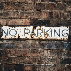 No Parking (Peter.Bartlett) Tags: square urbanarte lunaphoto peterbartlett old text antique texture brick mobilephone cellphone iphone5s wall sign noparking vsco