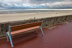 Le banc face  la mer (Lucille-bs) Tags: europe france picardie hautsdefrance somme baiedesomme fortmahonplage plage banc muret facelamer promenade ciel nuage sable