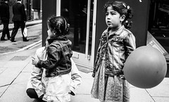 The big sister gets the big balloon (M.DStreets) Tags: amateur blackwhite blackandwhite bw candid contrast centre child children drama expression face faces girl happy innercity inspiration kid mdstreets monochrome manchester mirrorless mono mft northwest outdoor portrait pavement street streets travel urban outdoors