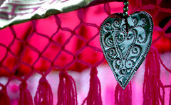 Tin Heart (reena azim negi) Tags: pink light shadow summer bali ontario canada motion blur west heritage texture motif floral metal closeup rural umbrella silver print botanical tin gold design beads movement community day pattern shine village heart graphic bright wind metallic decorative border decoration fuchsia windy blowing fringe canadian holes historic parasol shade edge northamerica string swirl summertime underneath bent breeze shape rim decor sheen weave indonesian puncture bayfield tassel perforated pompom balinese westernontario huroncounty henrywolseybayfield